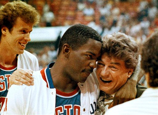 Description of . FILE - In this May 13, 1987 file photo, Detroit Pistons coach Chuck Daly hugs guard Joe Dumars after the Pistons won the second round of the NBA playoffs, defeating the Atlanta Hawks 104-96, in Atlanta. The FBI investigated a series of threatening letters sent to Daly at the height of his team's success during the 1989-90