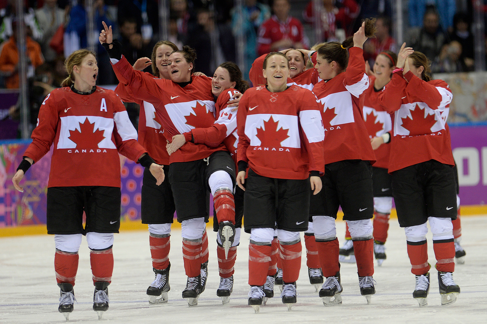 . SOCHI, RUSSIA - FEBRUARY 20: Team Canada celebrates after the overtime period of Canada\'s 3-2 gold medal ice hockey win over the U.S.A. Sochi 2014 Winter Olympics on Thursday, February 20, 2014 at Bolshoy Ice Arena. (Photo by AAron Ontiveroz/ The Denver Post)