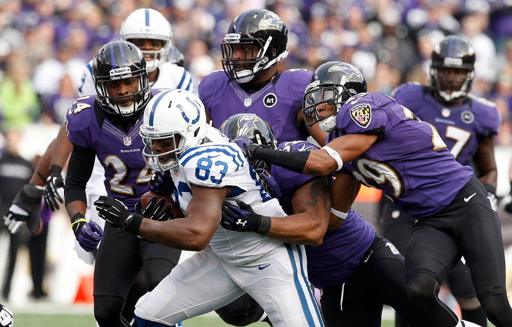 . Indianapolis Colts tight end Dwayne Allen is swarmed by Baltimore Ravens Cary Williams (R), Ray Lewis, DeAngelo Tyson (C) and Corey Graham (L) during the second quarter of their NFL AFC wildcard playoff football game in Baltimore January 6, 2013. REUTERS/Jonathan Ernst
