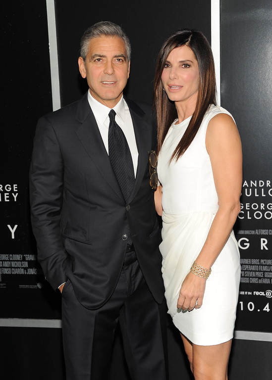 """. Actors George Clooney and Sandra Bullock attend the premiere of \""""Gravity\"""" at the AMC Lincoln Square Theaters on Tuesday, Oct. 1, 2013 in New York. (Photo by Evan Agostini/Invision/AP)"""