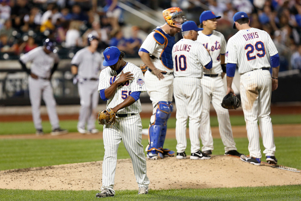 . New York Mets starting pitcher Jenrry Mejia is relieved in the sixth inning of a baseball game against the Colorado Rockies at Citi Field, Tuesday, Aug. 6, 2013, in New York. (AP Photo/John Minchillo)