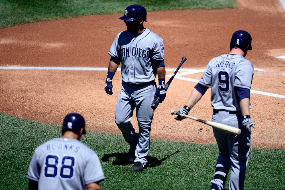. San Diego Padres center fielder Alexi Amarista (5) walks off the field after striking out against Colorado Rockies starting pitcher Juan Nicasio (44) during the first inning in Denver. The Colorado Rockies hosted the San Diego Padres at Coors Field on Sunday, June 9, 2013. (Photo by AAron Ontiveroz/The Denver Post)