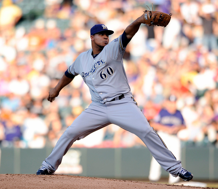 . Milwaukee Brewers starting pitcher Wily Peralta throws in the first inning of a baseball game against the Colorado Rockies, Friday, July 26, 2013, in Denver. (AP Photo/Chris Schneider)