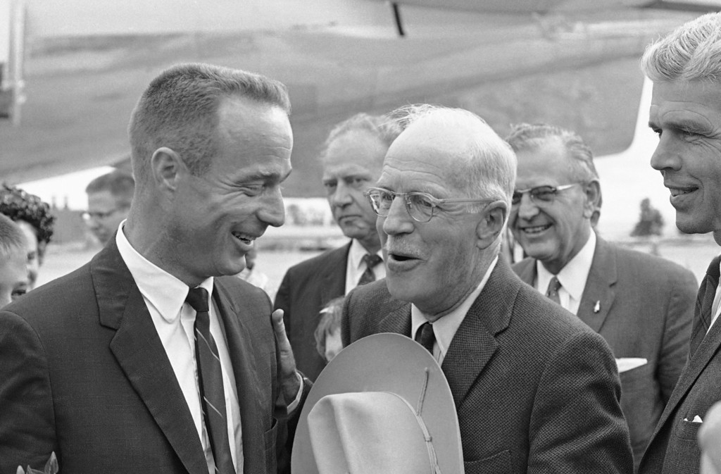 . Astronaut Scott Carpenter and his father, Marion Scott Carpenter, greet each other after the astronaut?s arrival in Denver on May 28, 1962. The father holds his western hat in one hand and pats his son?s shoulder with the other. It was their first meeting since Carpenter?s orbital journey. In center is Colorado Gov. Steve McNichols. (AP Photo/WPS)