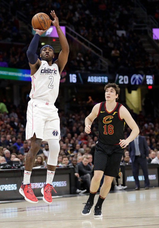. Washington Wizards\' John Wall (2) shoots as Cleveland Cavaliers\' Cedi Osman (16), from Turkey, watches in the second half of an NBA basketball game, Thursday, April 5, 2018, in Cleveland. (AP Photo/Tony Dejak)
