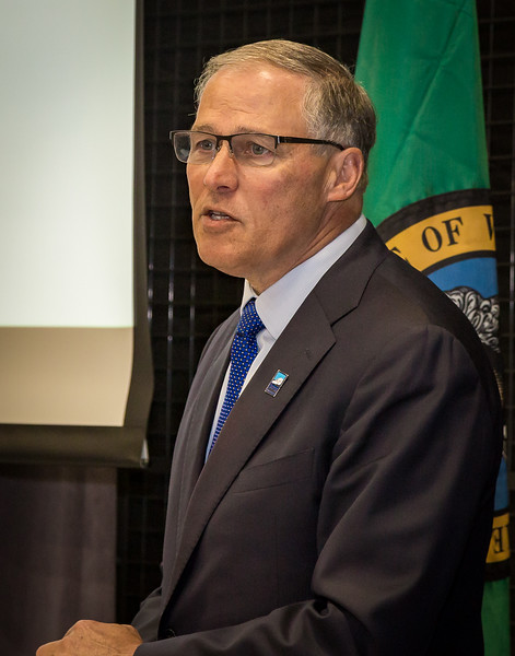 Governor Jay Inslee speaks to audience at corporate event.