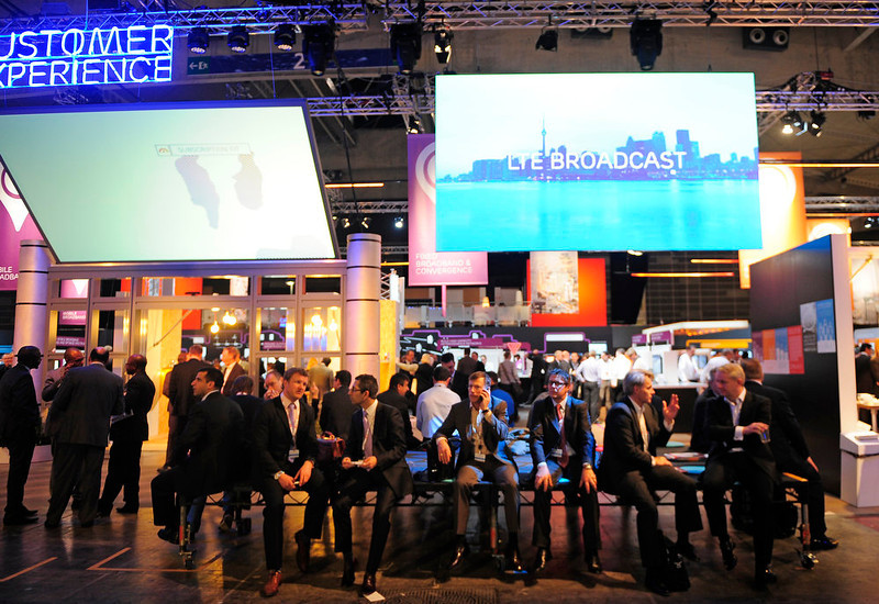 . Visitors are seen at the Ericsson stand at the Mobile World Congress, the world\'s largest mobile phone trade show, in Barcelona, Spain, Tuesday, Feb. 26, 2013. (AP Photo/Manu Fernandez)