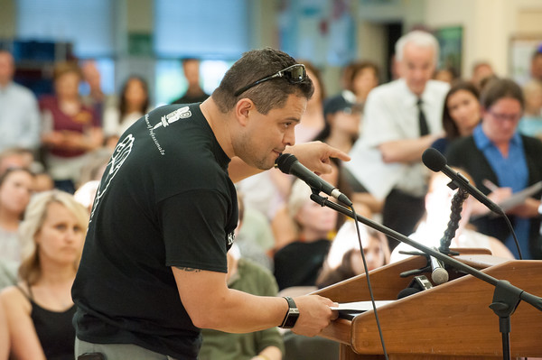 05/21/18 Wesley Bunnell   Staff A meeting of the New Britain Board of Ed took place to a packed standing room only crowd at Vance School on Monday night regarding recently announced changes for the upcoming 18-19 school year. Local 871 Union President Sal Escobales makes a point during his time to speak to the board.