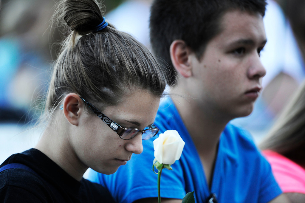 . AURORA, CO - JULY 20:  Rangeview High School students, Savannah Clemente, left, 16, and best friend, Brandon Manus, 16, reflect at the 7/20 Day of Remembrance 2013 at the Aurora Municipal Center Saturday morning, July 20, 2013. Over 200 people attended the service in honor of the 12 people killed and over 60 people injured in last years Aurora theater shooting. The service included prayer, songs and speeches from local officials and the Governor of Colorado, John Hickenlooper. Savannah lost her friend Jessica Ghawi, who was killed in the shooting July 20, 2012. (Photo By Andy Cross/The Denver Post)