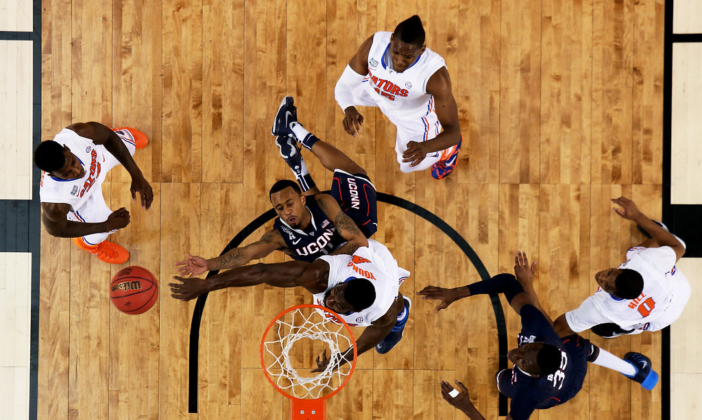 . ARLINGTON, TX - APRIL 05: Ryan Boatright #11 of the Connecticut Huskies goes to the basket as Patric Young #4 of the Florida Gators defends during the NCAA Men\'s Final Four Semifinal at AT&T Stadium on April 5, 2014 in Arlington, Texas.  (Photo by Tom Pennington/Getty Images)