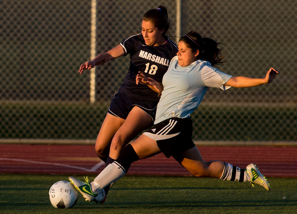 . Arroyo\'s Arianna Trujillo takes control of the ball from Marshall\'s Quetzali Del Villar in the first half of CIF soccer championship game, Arroyo vs. Marshall at Warren High School in Downey on Friday night, March 1, 2013. Marshall won 2-0. (SGVN/Staff photo by Watchara Phomicinda)