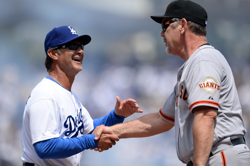 . Dodger manger Don Mattingly and Giants manager Bruce Bochy shake hands before the Dodgers\' home opener at Dodger Stadium Friday 4, 2014. The Giants beat the Dodgers 8-4.  (Photo by Hans Gutknecht/Los Angeles Daily News)