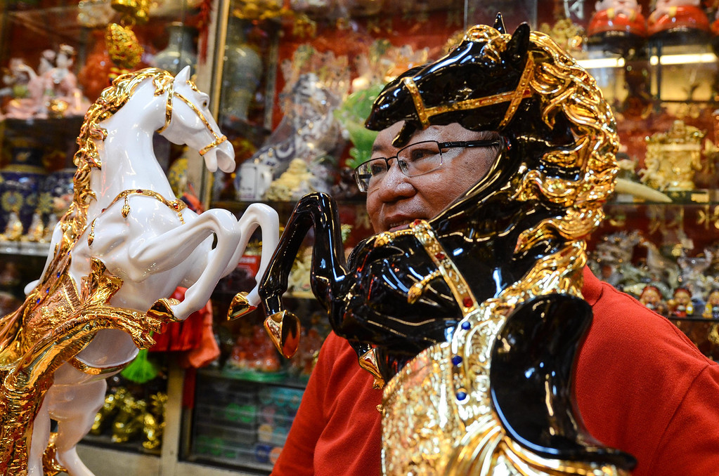 . A merchant displays a figurine of a horse in the Chinese district of Binondo on January 31, 2014 in Manila, Philippines.  (Photo by Dondi Tawatao/Getty Images)