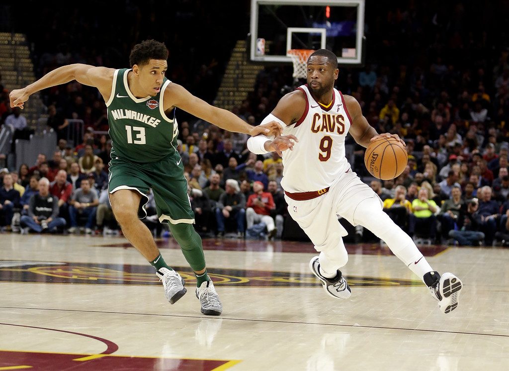 . Cleveland Cavaliers\' Dwyane Wade (9) drives against Milwaukee Bucks\' Malcolm Brogdon (13) in the first half of an NBA basketball game, Tuesday, Nov. 7, 2017, in Cleveland. (AP Photo/Tony Dejak)