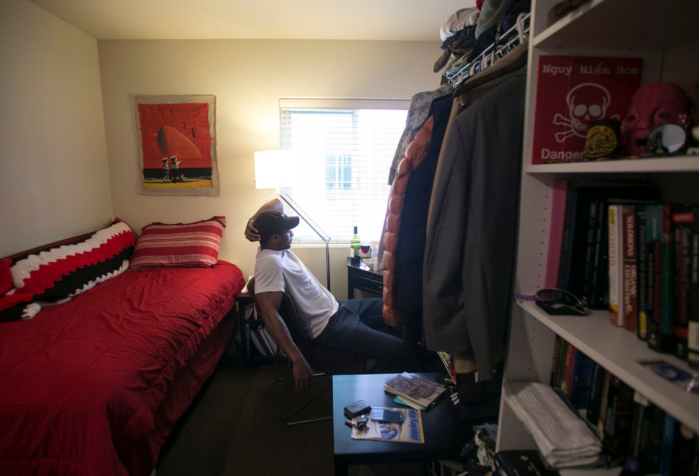 """. Jon-Christian Stubblefield relaxes inside of his 200 square foot Mini-Suite apartment in the First Hill neighborhood in Seattle, Washington May 12, 2013. \""""It was an affordable option living inside the city\'s core for under 1200,\"""" said Stubblefield who relocated to Seattle from Texas.    REUTERS/Nick Adams"""