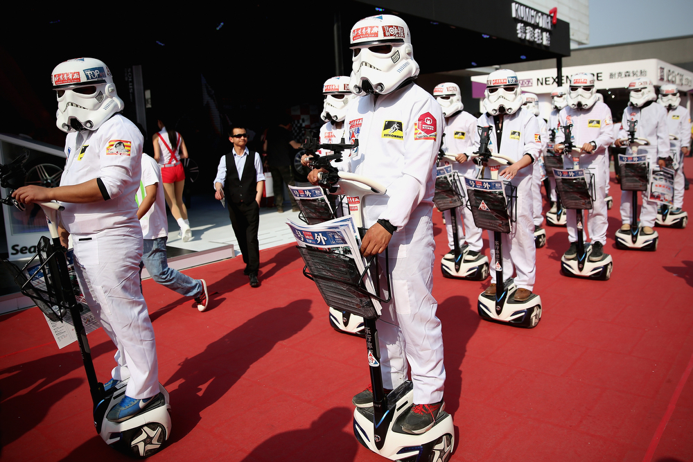 Description of . People dressed up as Imperial soldiers of Star Wars film distribute promotional manual to visitors during the 2014 Beijing International Automotive Exhibition at China International Exhibition Center on April 22, 2014 in Beijing, China. More than 2,000 automotive enterprises from 14 countries and regions participated in the 2014 Beijing International Automotive Exhibition from April 20 to April 29.  (Photo by Feng Li/Getty Images)