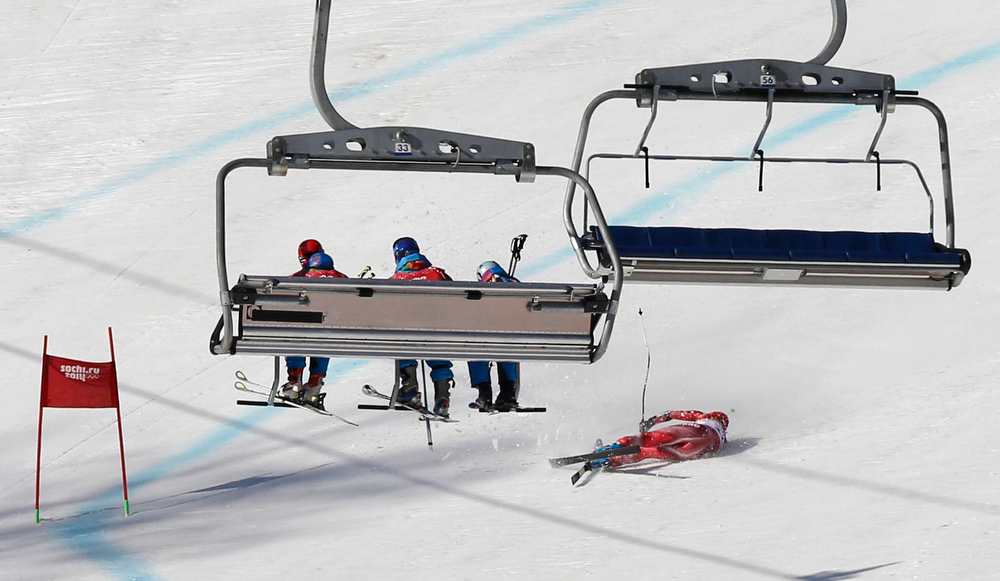 . Switzerland\'s Dominique Gisin lies on the course after falling in the women\'s super-G at the Sochi 2014 Winter Olympics, Saturday, Feb. 15, 2014, in Krasnaya Polyana, Russia. (AP Photo/Christophe Ena)