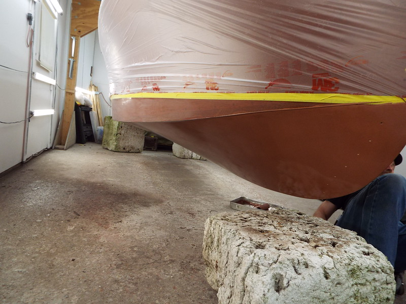 Starboard side with the first coat of bottom paint applied.