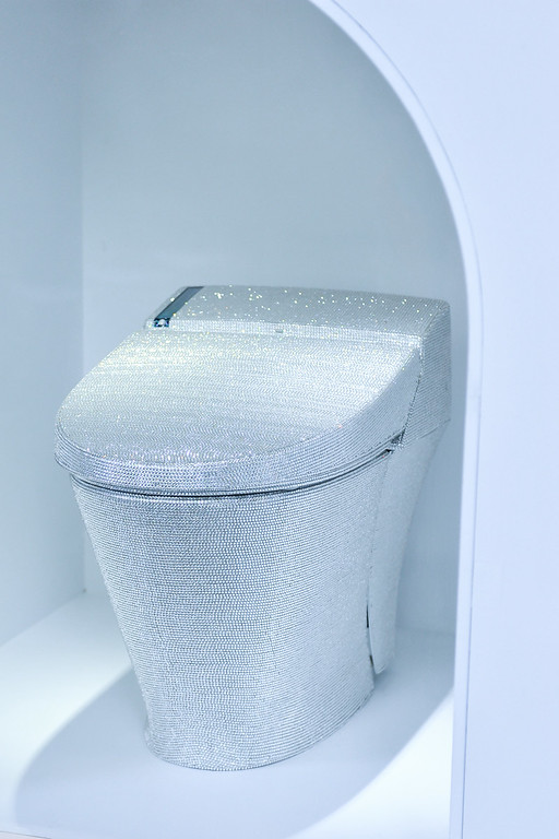 ". TOKYO, JAPAN - JULY 01:  A toilet decorated with crystal rhinestones is displayed with during the ""Toilet!? Human Waste and Earth\'s Future\"" exhibition at The National Museum of Emerging Science and Innovation - Miraikan on July 1, 2014 in Tokyo, Japan. The exhibition focuses on how the toilet has changed our daily lives and discovers what the most environment-friendly and ideal toilet is.  (Photo by Keith Tsuji/Getty Images)"
