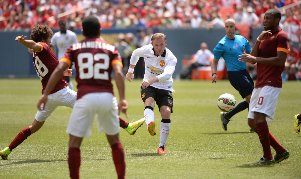. Manchester United striker Wayne Rooney used his right foot to put a shot into the corner of the net for the first goal of the match. Manchester United took on AS Roma in an exhibition soccer game at Sports Authority Field in Denver Saturday afternoon, July 27, 2014. Photo by Karl Gehring/The Denver Post