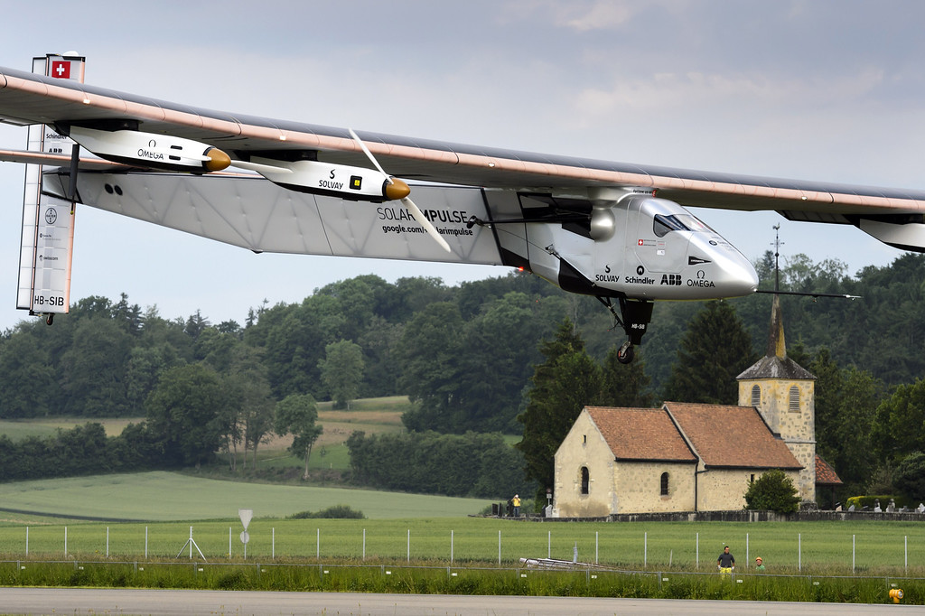 """. German test pilot Markus Scherdel lands the new experimental aircraft \""""Solar Impulse 2\"""", after its first flight at the airbase in Payerne, Switzerland, on June 2, 2014.  AFP PHOTO / POOL / LAURENT GILLIERON/AFP/Getty Images"""