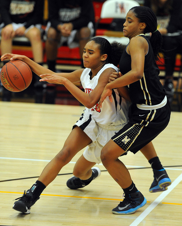 . STUDIO CITY - 02/16/13 - (Photo: Scott Varley, Los Angeles Newspaper Group)  CIF Southern Section Division IV-AA second-round girls basketball playoff game. Bishop Montgomery vs Harvard-Westlake. Bishop Montgomery won 57-42. H-W\'s Jordan Brown works her way around Chelsea Lidy.