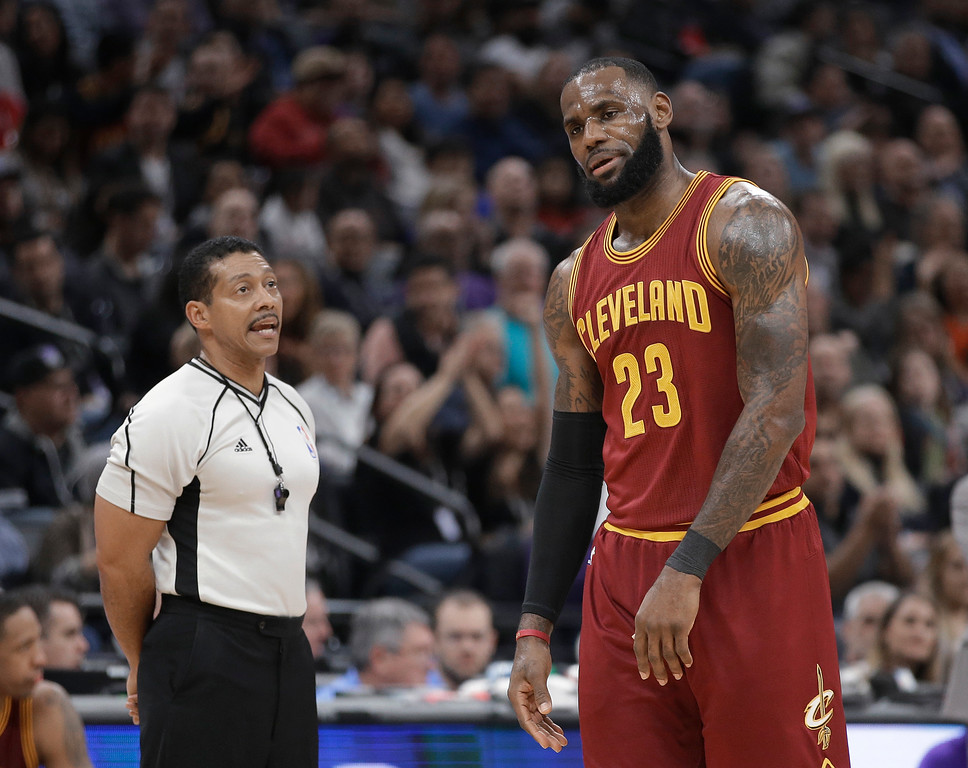 . Cleveland Cavaliers forward LeBron James, right, reacts after being called for a technical foul by referee Bill Kennedy, left, during the first quarter of an NBA basketball game against the Sacramento Kings, Friday, Jan. 13, 2017, in Sacramento, Calif. (AP Photo/Rich Pedroncelli)
