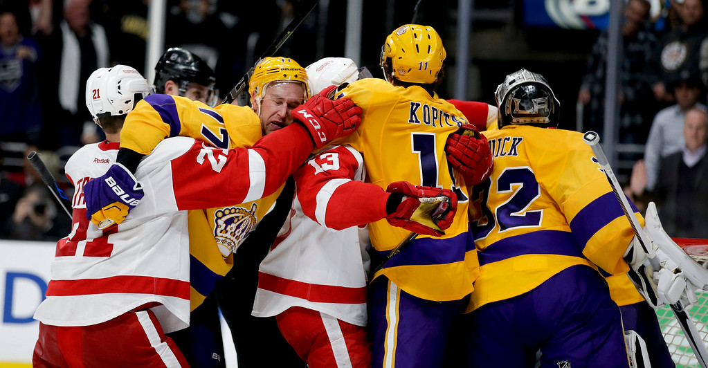 . Members of the Los Angeles Kings and Detroit Red Wings brawl during the third period of an NHL hockey game in Los Angeles, Tuesday, Feb. 24, 2015. The Kings won 1-0. (AP Photo/Chris Carlson)