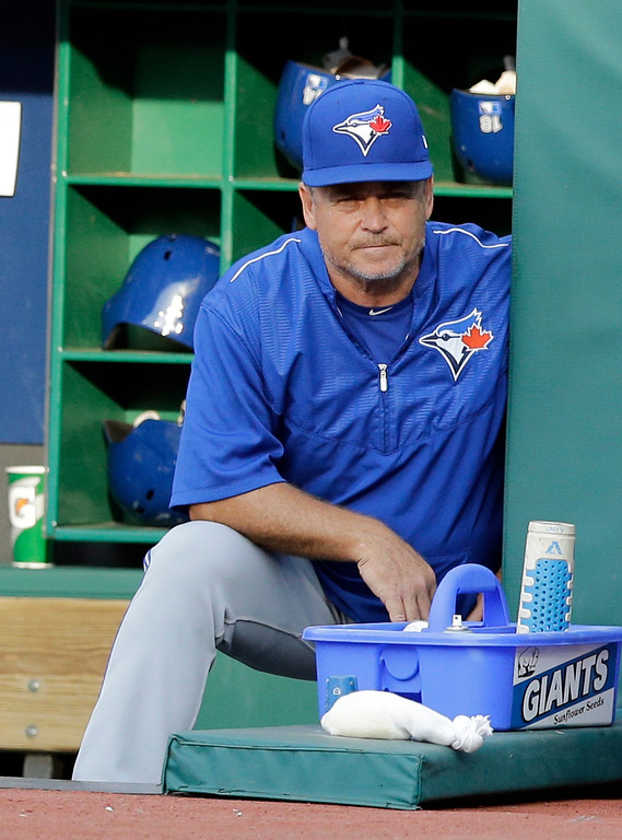. Toronto Blue Jays manager John Gibbons watches in the first inning of a baseball game against the Cleveland Indians, Friday, July 21, 2017, in Cleveland. (AP Photo/Tony Dejak)