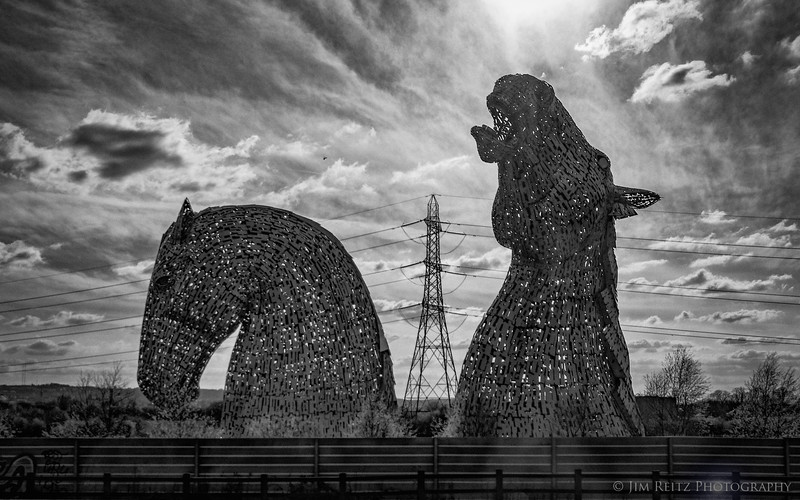 """The Kelpies"" - an amazing piece of roadside art along the Forth & Clyde Canal outside Edinburgh, Scotland. 100-foot tall metal sculptures, a tribute to the work horses that pulled barges along this canal between Glasgow & Edinburgh. A ""Kelpie"" is a mythological, shape-shifting water spirit."