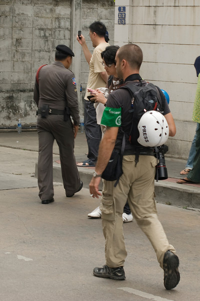 Media folks carrying helmet during Red Shirt Protest - Thailand