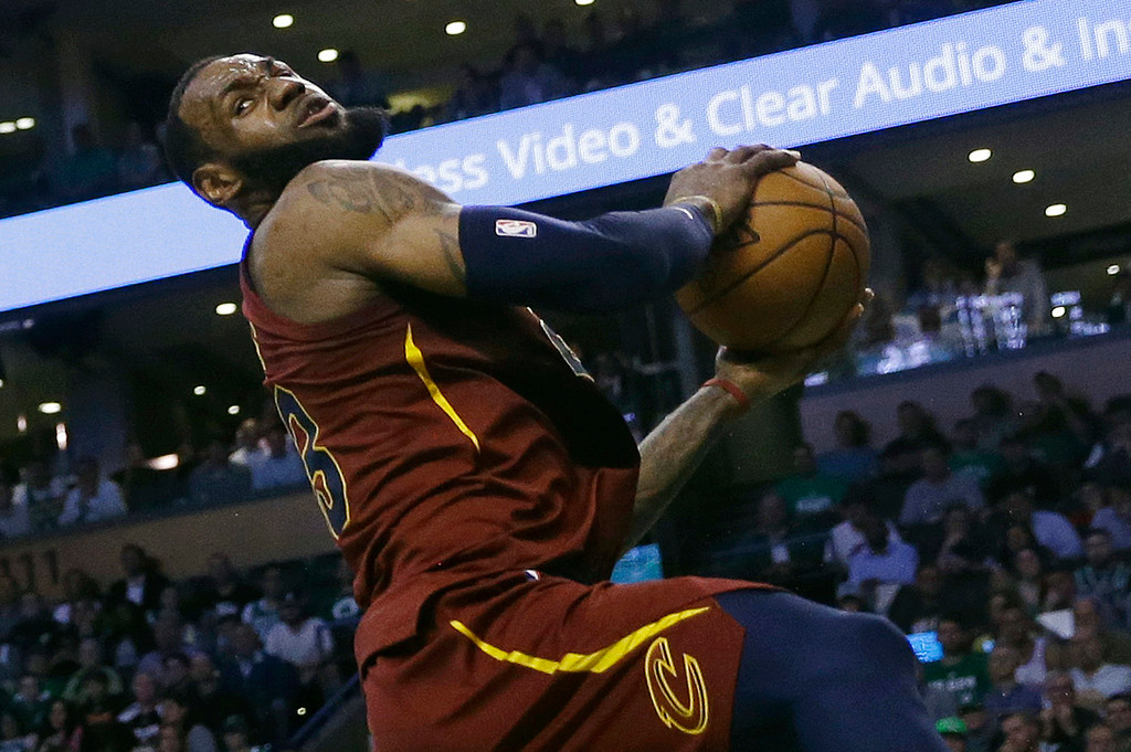. Cleveland Cavaliers forward LeBron James recoils after colliding with Boston Celtics forward Jayson Tatum during the first half in Game 2 of the NBA basketball Eastern Conference finals Tuesday, May 15, 2018, in Boston. (AP Photo/Charles Krupa)