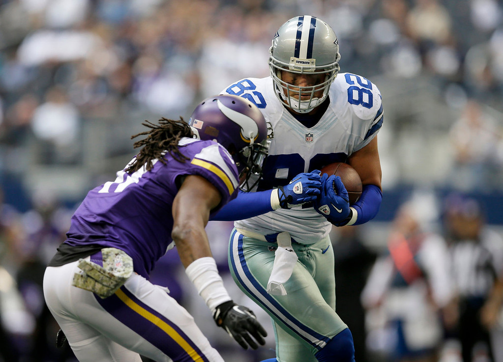 . Minnesota Vikings\' Mistral Raymond (41) attempts the tackle on Dallas Cowboys\' Jason Witten (82) who runs into the end zone for a touchdown after grabbing a pass from quarterback Tony Romo in the second half of an NFL football game, Sunday, Nov. 3, 2013, in Arlington, Texas. (AP Photo/Tim Sharp)