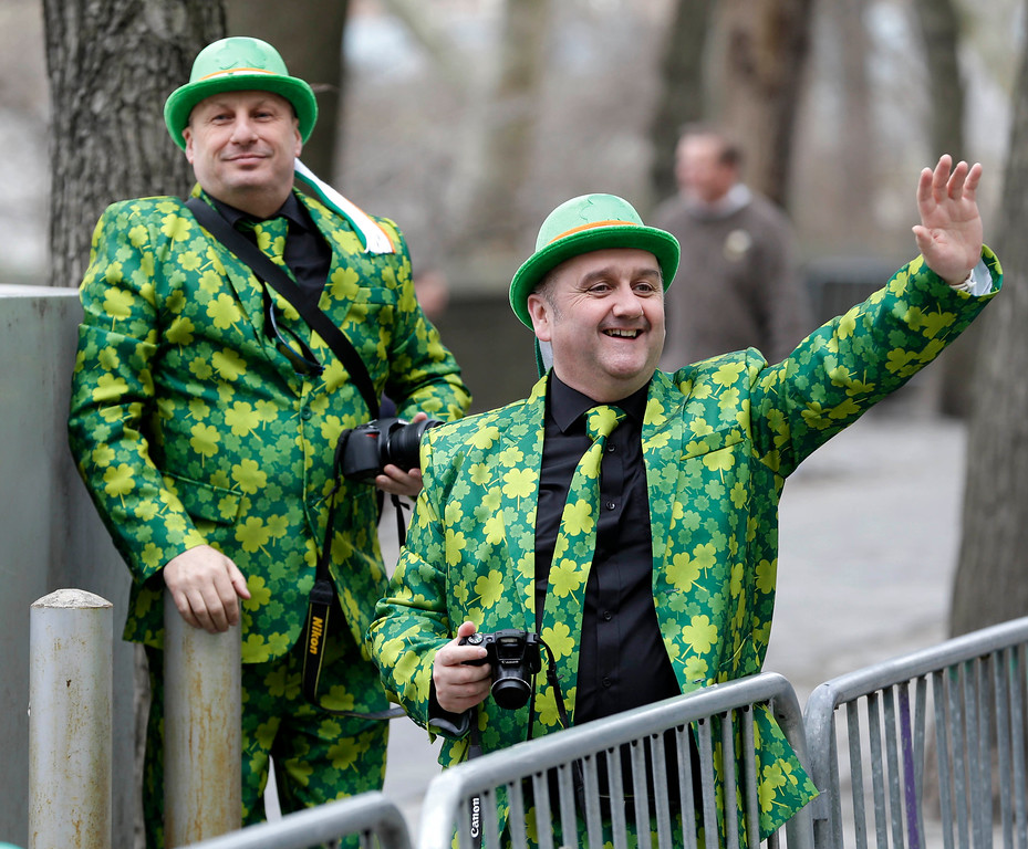 . Neil Martin, right, and Martin Brown, both from Belfast, Ireland, watch the St. Patrick\'s Day Parade in New York, Tuesday, March 17, 2015. (AP Photo/Seth Wenig)