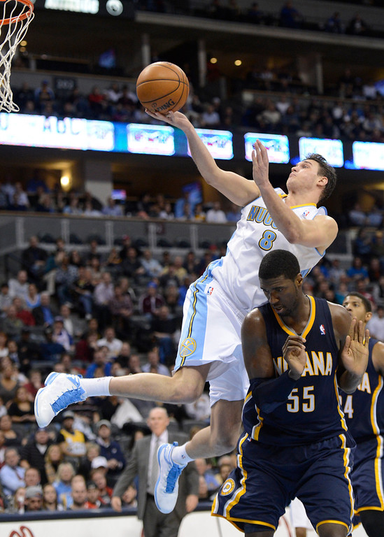 . DENVER, CO. - JANUARY 28: Denver Nuggets small forward Danilo Gallinari (8) throws up an awkward shot over Indiana Pacers center Roy Hibbert (55)  during the fourth quarter January 28, 2013 at Pepsi Center. The Denver Nuggets defeated the Indiana Pacers 102-101 in NBA Action. (Photo By John Leyba / The Denver Post)