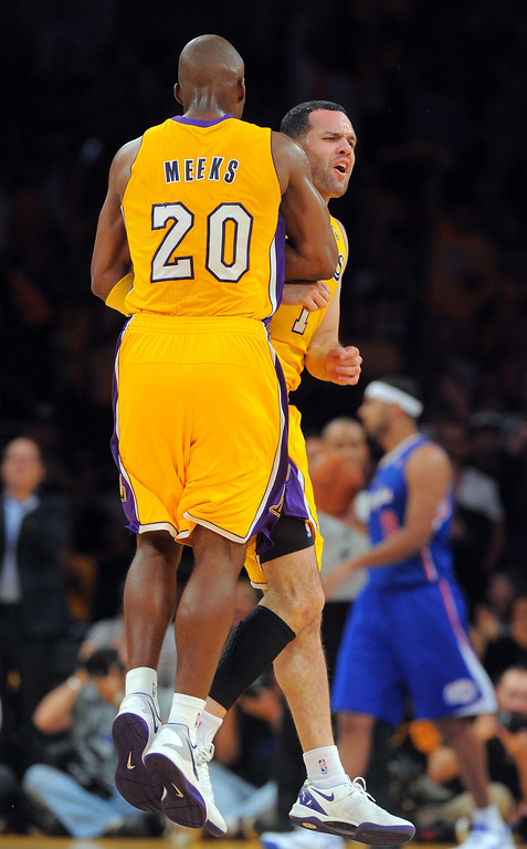 . Jordan Farmar celebrates a basket with Jodie Meeks (20) in the NBA season opener between the Lakers and Clippers at Staples Center in Los Angeles, CA on Tuesday, October 29, 2013.  Lakers won 116-103. (Photo by Scott Varley, Daily Breeze)