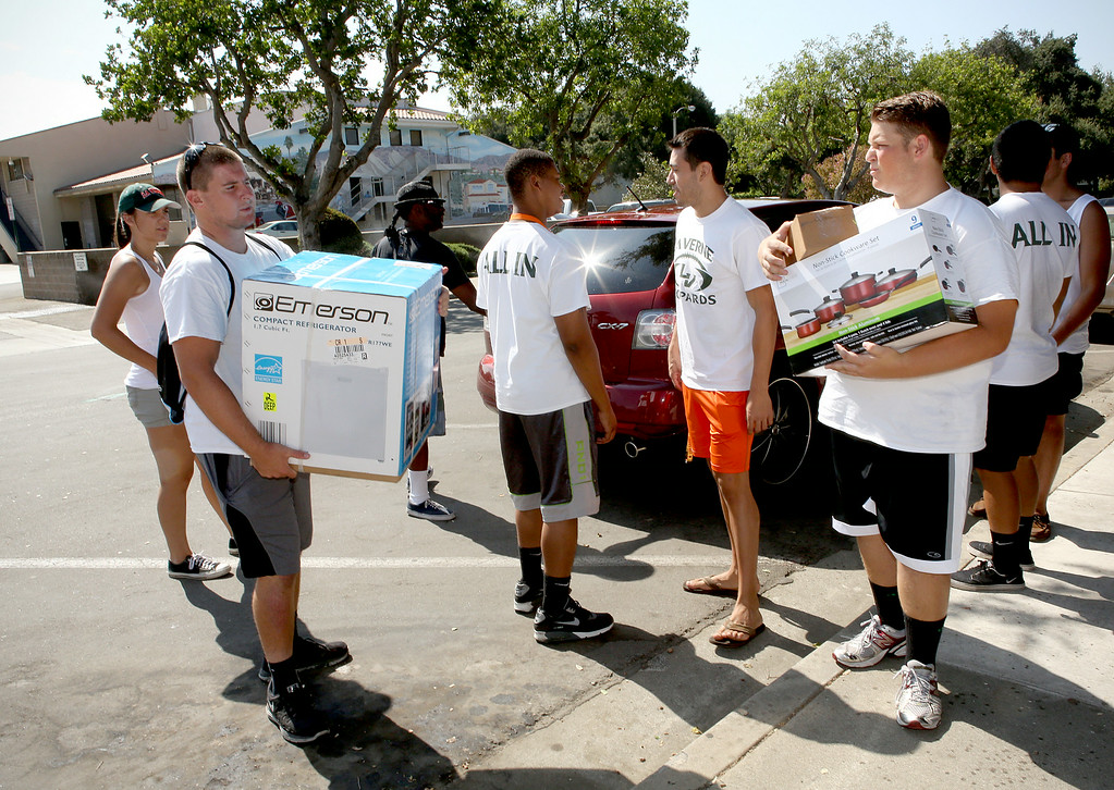 . Members of the University of La Verne football team were among the volunteers helping new students move into the dorms Wednesday August 20, 2014, as they get ready for the new fall semester at the University of La Verne, in August 2014. (Nancy Newman/for the Inland Valley Daily Bulletin)