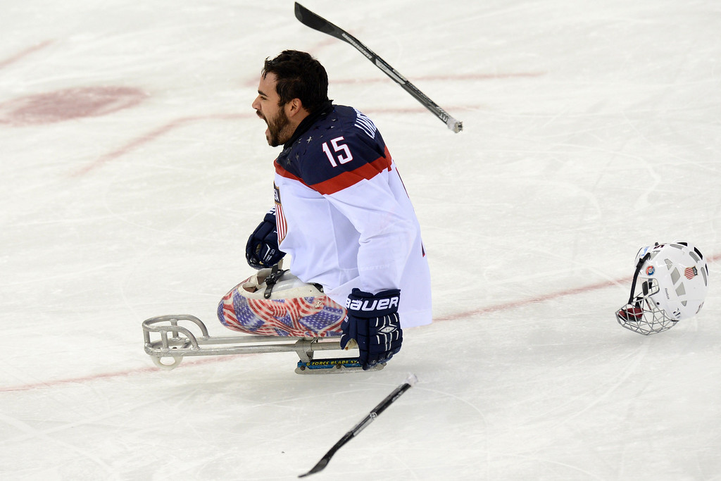 . United States\' Nikko Landeros celebrates his team\'s  victory in the Sledge Hockey Final match against Russia  at XI Paralympic Olympic games in the Shayba stadium near the city Sochi on March 15, 2014. USA won 1-0.  AFP PHOTO/KIRILL KUDRYAVTSEV/AFP/Getty Images