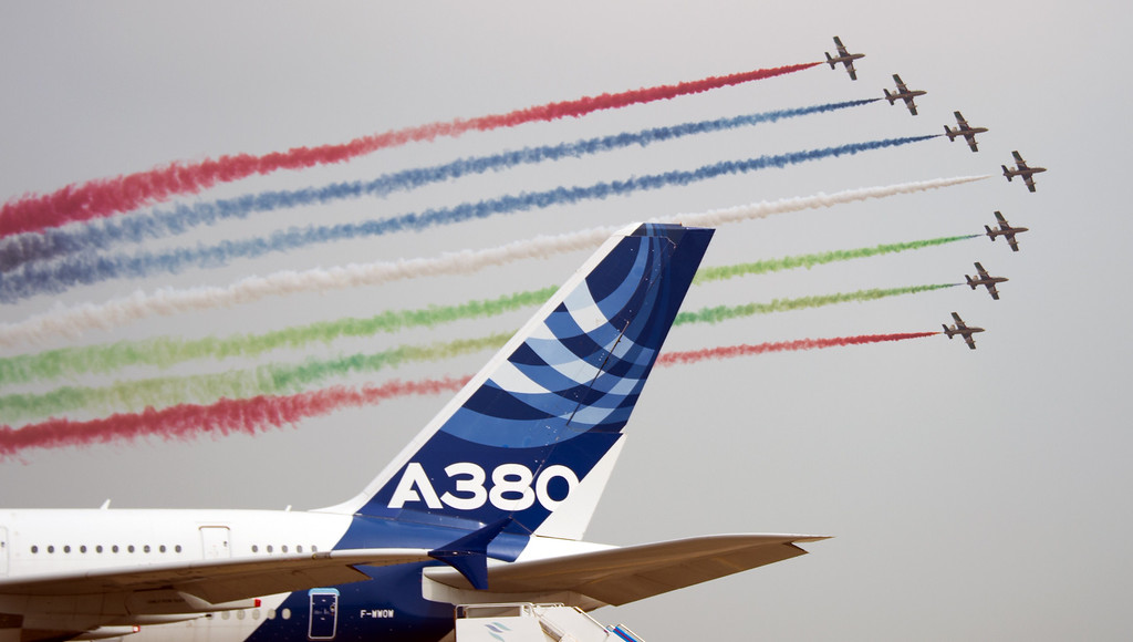 . The United Arab 1st Aerobatic team perform in their MB-339A jets perform next to an Airbus A380 jet at the Airshow China 2014 in Zhuhai, south China\'s Guangdong province on November 12, 2014.    AFP PHOTO / JOHANNES  EISELE/AFP/Getty Images