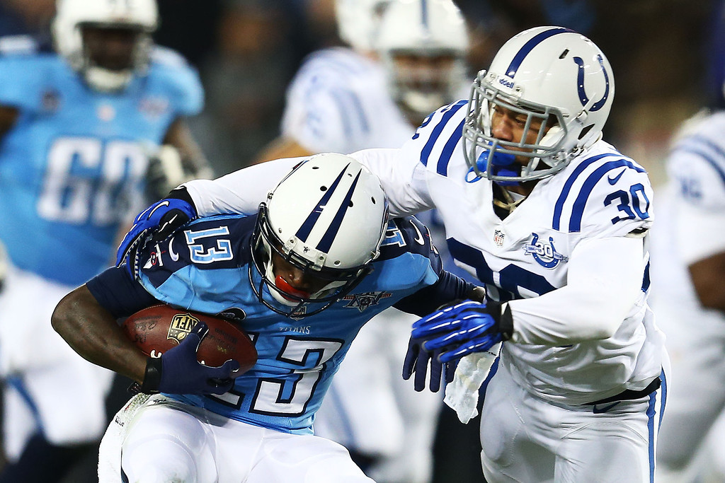 . NASHVILLE, TN - NOVEMBER 14:   Kendall Wright #13 of the Tennessee Titans tries to break the tackle of  LaRon Landry #30 of the Indianapolis Colts in the first quarter at LP Field on November 14, 2013 in Nashville, Tennessee.  (Photo by Andy Lyons/Getty Images)