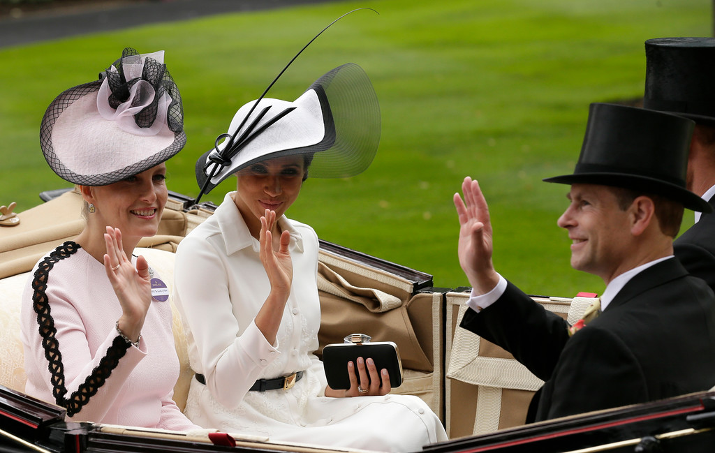 . Britain\'s Prince Harry and Meghan, Duchess of Sussex, arrives at the parade ring with Prince Edward, Earl of Wessex, and Sophie, Countess of Wessex, in a horse drawn carriage on the first day of the Royal Ascot horse race meeting in Ascot, England, Tuesday, June 19, 2018. (AP Photo/Tim Ireland)