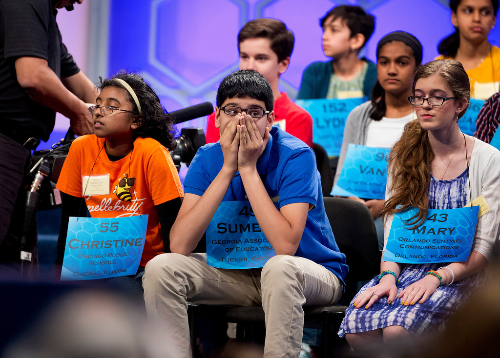 . From front left: Christine Alex of Chicago, Sumedh Garimella of Duluth, Ga., and Mary Horton of West Melbourne, Fla., wait for their turn during the semifinals of the Scripps National Spelling Bee, Thursday, May 29, 2014, at National Harbor in Oxon Hill, Md.  (AP Photo/Manuel Balce Ceneta)