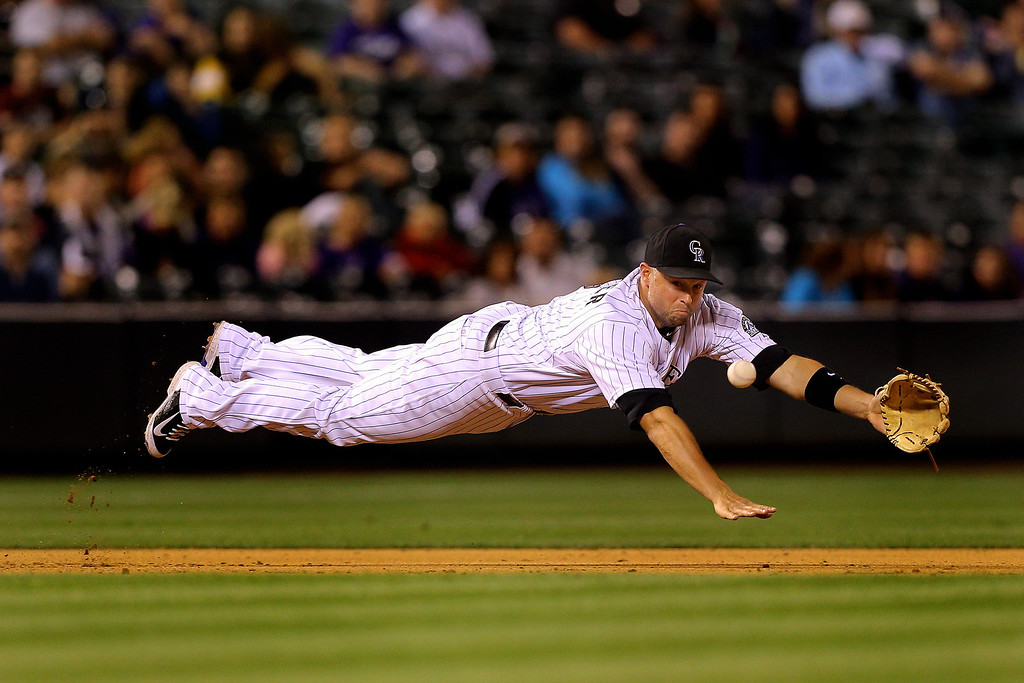 . Third baseman Michael Cuddyer #3 of the Colorado Rockies dives but comes up short on a base hit by Miguel Montero (not pictured) of the Arizona Diamondbacks during the ninth inning at Coors Field on June 5, 2014 in Denver, Colorado.  (Photo by Justin Edmonds/Getty Images)
