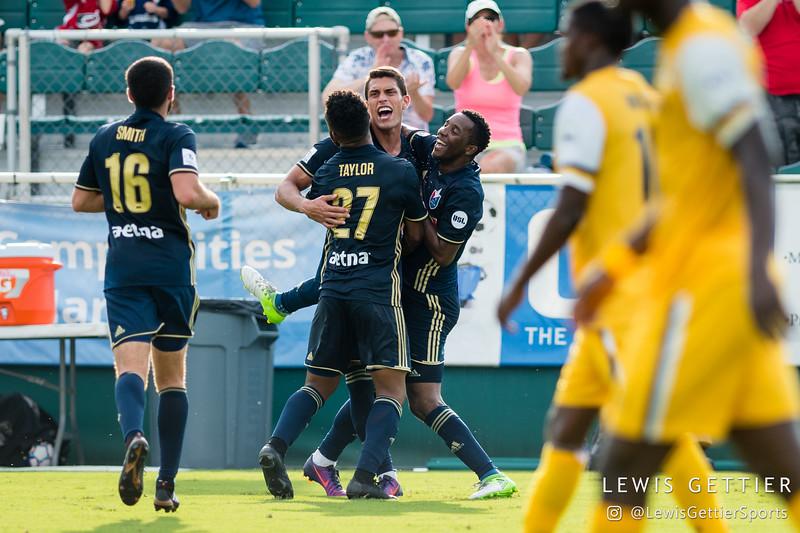 North Carolina FC forward Daniel Rios (14) celebrates his goal with North Carolina FC midfielder Tiyi Shipalane (22) and North Carolina FC defender D.J. Taylor (27)