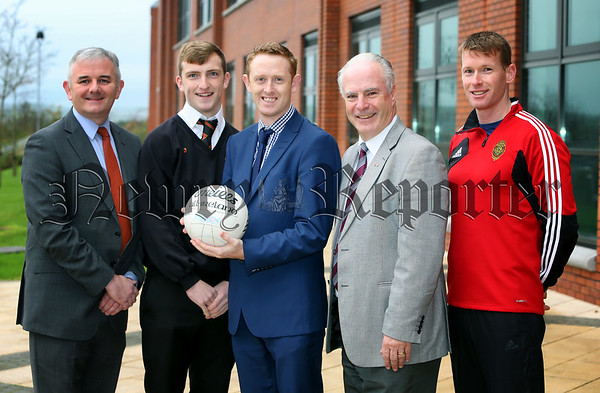 CAPTION:<br /> <br /> Pictured at the visit by Kerry legend, Colm Cooper to Abbey Grammar School, Newry are (l-r) Stephen Comer Senior Manager First Trust Bank; Patrick Murdock, McCrory Cup Captain; Colm Cooper;  Dermot McGovern, school Principal and Jody Gormley, teacher.