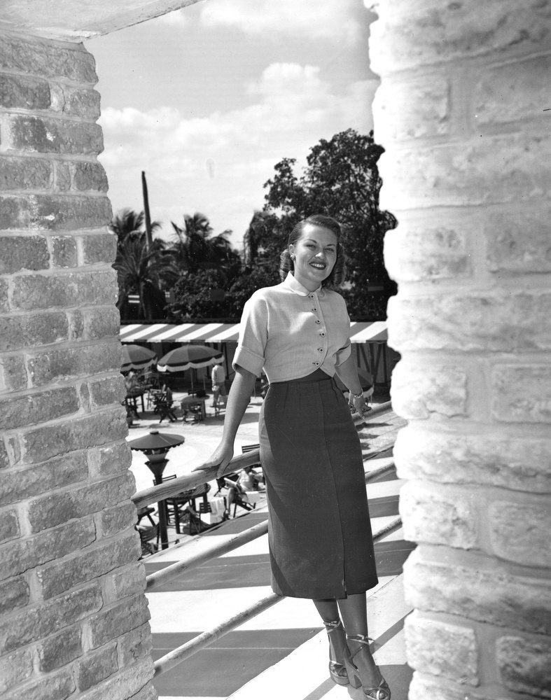 . Singer Patti Page is shown wearing a weekend ensemble by Wilroy of New York in Miami, Fla., on March 24, 1951.  Page wears a short, rounded jacket over a long skirt with a high-riding belt that is part of a four-piece ensemble.  (AP Photo)