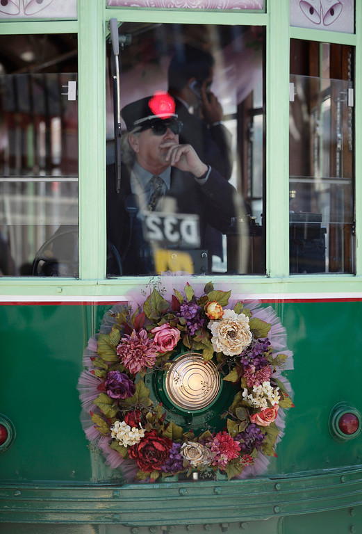 . Conductor, Steve Hawkins, operates the trolley carrying Ralph and Mary Lou Watkins and their guests during the Watkins\' 60th wedding anniversary party on board a Santa Clara Valley Transportation Authority historic trolley at the Diridon Station in San Jose, Calif. on Thursday, Feb. 14, 2013. Ralph, 82, and Mary Lou, 79, won an essay contest sponsored by the VTA to have the opportunity to renew their vows on historic trolley, Car 2001. The couple held a private ceremony aboard the trolley and held a brief reception on the VTA Light Rail platform.  (Gary Reyes/ Staff)