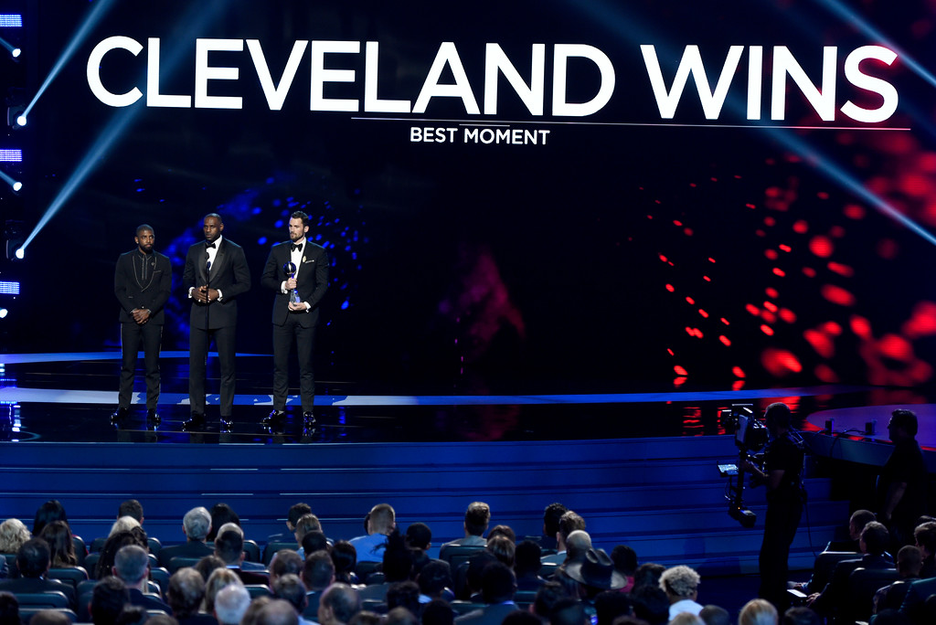 . Cleveland Cavaliers\' Kyrie Irving, from left, LeBron James, and Kevin Love accept the award for best moment for their team�s 2016 NBA Finals Championship at the ESPY Awards at the Microsoft Theater on Wednesday, July 13, 2016, in Los Angeles. (Photo by Chris Pizzello/Invision/AP)