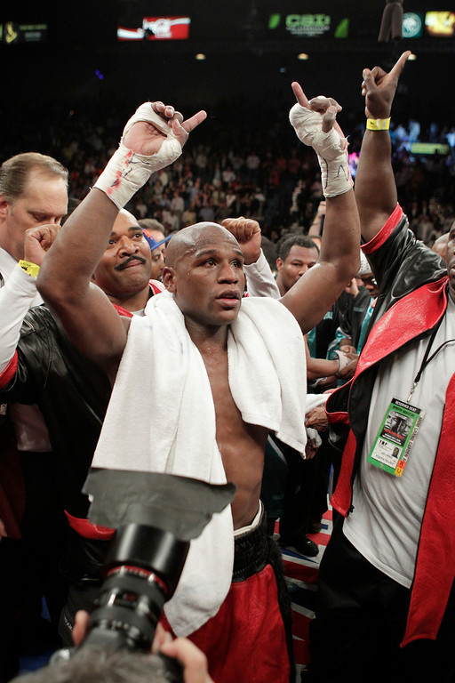 . Floyd Mayweather Jr., celebrates his victory over Shane Mosley, in their WBA welterweight boxing match Saturday, May 1, 2010, in Las Vegas.  (AP Photo/Jae C. Hong)