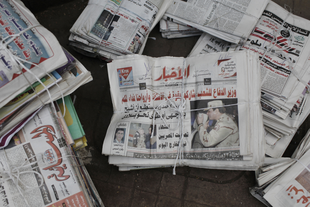 . An Egyptian newspaper shows a picture of Defense Minister General Abdul Fattah al-Sisi near a polling booth in the district of Zamalek on January 14, 2014 in Cairo, Egypt. Some clashes, between protesters and security forces, and one explosion were reported in the Egyptian capital Cairo, at a courthouse in the district of Imbaba, as voting began early on Tuesday. Egyptians will go to the polls on Tuesday and Wednesday to decide on the third constitution for Egypt since the overthrow of former President Hosni Mubarak in February 2011. (Photo by Ed Giles/Getty Images).
